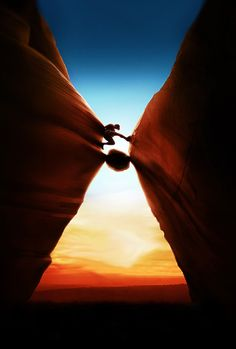 "The poster for the film ""127 hours"" has a huge hour glass on it. The rock his hand is trapped under, possibly being a grain of sand....."