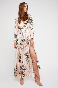 In Bloom Maxi Dress | Silky floral printed maxi dress featuring pleat detailing on the skirt.   * Plunging V-neckline * Button closures down the front * Front slit detail