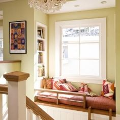 Reading nook...by a window, cute, and an added advantage because it's by the stairs. You get to keep an eye on people as they walk by...all while reading a book:)