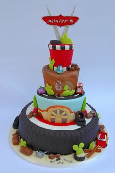 Cars cake  - I just love the big tire tread for the bottom tier vsl