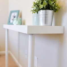 Need a small table for a small space? Make this illusion console table using IKEA elements for just $22!