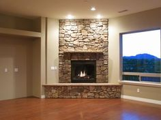 Gray walls and stone fireplace