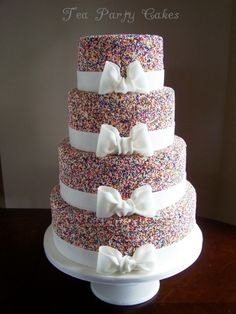 Sprinkles wedding cake by Tea Party Cakes .I like, but maybe different colored sprinkles Pretty Cakes, Cute Cakes, Beautiful Cakes, Amazing Cakes, Sprinkle Wedding Cakes, Round Wedding Cakes, Sprinkle Cakes, Bow Cakes, Cupcake Cakes