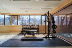 Snowcapped mountains provide an idyllic backdrop for architect Peter Marino's Rocky Mountain fitness room.