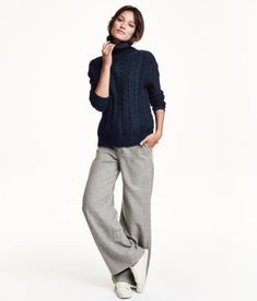 Wide, flared flannel trousers in a wool blend with side pockets, back welt pockets and a regular waist with a concealed hook-and-eye fastener.