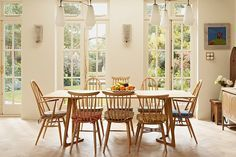 Love the mix of spindle chairs! London Residence by Godrich Interiors | Home Adore