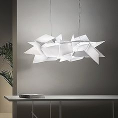 Redefining unique, the Cordoba Pendant by Slamp carries a compelling contemporary verve into your home. This stunning piece is handcrafted with a special polymer that fiercely diffuses light in different directions. Giving the impression of skillfully folded origami, the asymmetrical fragments of material shatters the light into the environment. Sure to impress, this pendant is an inspired example of progressive contemporary lighting.