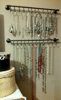 My new jewelry organization!  Love it!  Got the idea off Pinterest, of course!  Thank you to my husband for hanging the bars up for me!