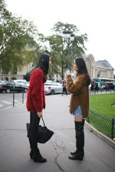 omg, I kinda LOVE the muppet/sleek black combo of the outfit on the left. What fun! They Are Wearing: Paris Fashion Week - Slideshow - WWD.com