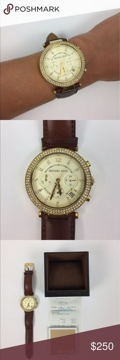 Michael Kors Gold & Leather Rhinestone Watch Michael Kors rhinestone watch with stainless steel backing. Gold hardware and brown leather watchband. This watch has been worn a handful of times and is in like new condition. Price is firm and item cannot be bundled. Comes with box and cushion, original receipt and owner's manual. A040 MICHAEL Michael Kors Accessories Watches