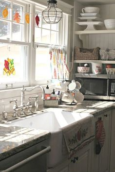 Kitchen towels as curtains in white kitchen with farmhouse sink-www.goldenboysandme.com