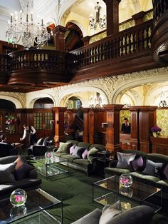 Stunning interior from our Woodlands Park Hotel in Cobham, Surrey. The Grand Hall has stained glass windows in the ceiling, beautiful woodwork, a feature fireplace and elegant furniture all serving to create a sense of grandeur.