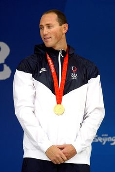 Jason Lezak of the United States poses with the gold medal during the medal ceremony for the Men's 4 x 100m Freestyle Relay.