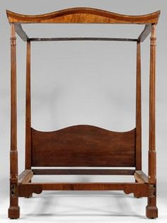 fin A George III tester bed with carved and reeded posts, mahogany, probably British, late 18th or early 19th century