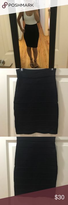 Black high waist skirt Black middy high waisted skirt. bebe Skirts Midi