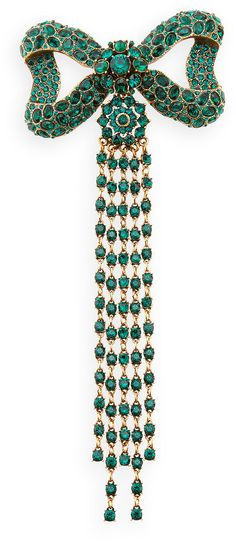 EMERALD BOW BROOCH WITH LONG EMERALD BEAD FRINGE.