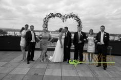 Bridal party fun on the roof of Frazier Arms Museum in Louisville, Ky  www.photographybyjwest.com