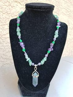 Check out this item in my Etsy shop https://www.etsy.com/listing/534181298/fluorite-pendant-necklace