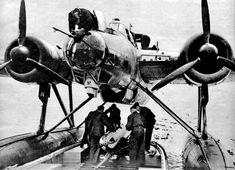 He 115 C4 aircraft loading a LT F 5b practice torpedo