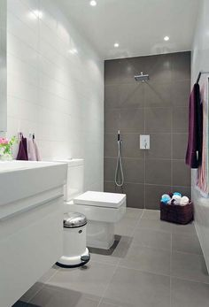 Modern Bathroom With Same Tile On Floor And Wall; Main Wall Tiled To  Ceiling.