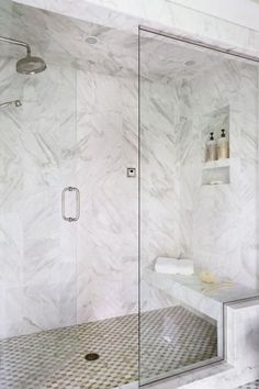 Calacatta Gold marble and Walker Zanger mosaic tiles line the walk-in steam shower outfitted with both a rainhead and hand shower. Dream Shower! - Traditional Home ® / Photo: Werner Straube / Design: Rosemary Merrill #SteamShower