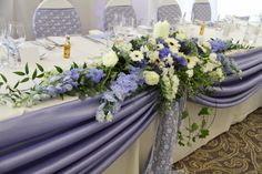 Beautiful periwinkle top table swagging, periwinkle taffeta sashes with ivory lace overlay completes the look.