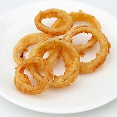 Gluten Free Onion Rings! Oven baked, crispy and delicious. Use this batter to coat and bake any treat for the little one with gluten intolerance:)