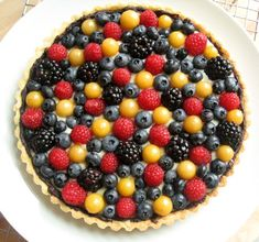 Classic Fruit Tart: sweet sugar cookie pastry crust, a hidden chocolate lining, a velvety rich pastry cream filling and — last but certainly not least — a beautifully arranged crown of fresh fruits and berries!