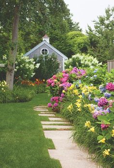 Pale yellow daylilies, pink/blue and white hydrangeas.  Nice path.