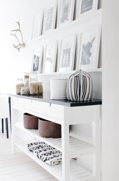 Love the picture shelves above the console table