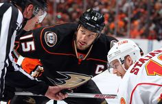 Ryan Getzlaf #15 of the Anaheim Ducks faces off against Matt Stajan #18 of the Calgary Flames during the first period in Game Two of the Western Conference Semifinals during the 2015 NHL Stanley Cup Playoffs at Honda Center on May 3