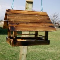 These feeders are handmade using reclaimed wood. Each feeder measures about 10 inches across x 12 inches long. They stand about 12 inches tall. They can be hung from a tree, a feeding post or even screwed to a deck railing. Finished in a burnt look,and seal to protect from the weather. Each feeder comes with it's own unique traits. Because the wood has been reclaimed, there may be small nail holes and the like. This is to be expected.