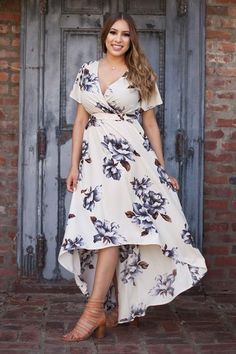 Back in stock! Our most-loved high low maxi dress in a gorgeous floral print! With romantic details and a flowing hemline, you'll feel like the prettiest girl in the room. Dress it up with heels and s