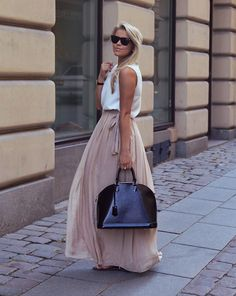 white sleeveless top, beige maxi skirt, black patent leather louis vuitton epi bag, braid, wayfarers, watch