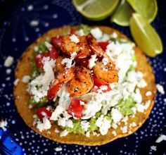 BBQ Grilled Shrimp Tostadas with fresh smashed avocado, creamy cilantro lime slaw, tomatoes, and queso fresco