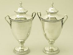 A fine and impressive pair of antique Georgian English sterling silver sugar vases; an addition to our ornamental silverware collection