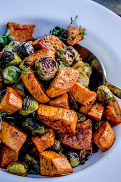 ROASTED SWEET POTATOES & BRUSSELS SPROUTS || garlic, olive oil, cumin, garlic salt, salt/pepper, red wine vinegar, fresh thyme