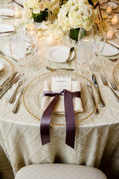 Katherine and Mark – Feature Wedding by Caprisio, LLC. Trump National Golf Club Bedminster NJ, Wedding. Ivory reception tables with clear plates with gold trim and purple accents. http://www.caprisio.com