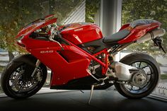 Ducati 848. Want one so bad. Mom said she buy me one after graduation.