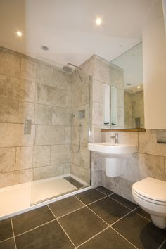 large bathroom tiles dark grey and light brown