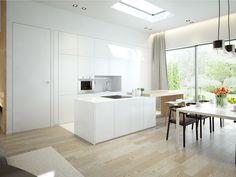 Wysoka zabudowa kuchenna w kolorze białym oraz wyspa z drewnianym dębowym blatem