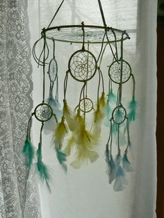 Dreamcatcher mobile ...I know my daughter is older but would still be cool in her room @Rhianna Wolf