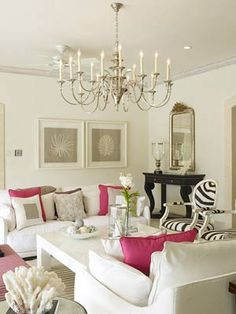 pretty room, with white, black, pink and some textures and earthiness thru the rug, sea prints and coral...