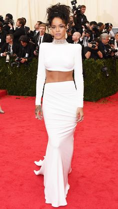 2014 Met Gala Red Carpet - Rihanna in Stella McCartney with jewelry by Cartier, Dionea Orcini, and Jacob & Co.