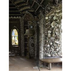 """""""A shell cottage in the grounds of Carton House begun in the second half of the 18th century. A passage leads into a domed shell room embellished with coral and stained glass."""""""