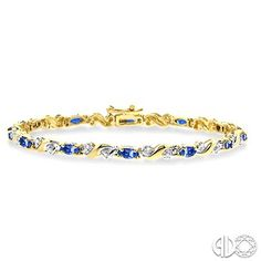 Symbolize your sweet love for her with this classy Tanzanite and Diamond Tennis Bracelet. This appealing bracelet is crafted in lustrous 10 karat yellow gold and features 12 magnificent prong set marquise shape tanzanite complemented by 24 miracle single cut diamonds in prong setting. The Bracelet fastens with a secure clasp. Total diamond weight is 1/5 Ctw and each tanzanite measures 5x2.5mm. #swansondiamondcenter #tanzanite #diamond #bracelet