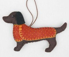 Handmade felt Dachshund dog ornament for Christmas or any occasion. Bruno is a Dachshund made from dark brown felt, with a jolly buttoned jacket in orange dotty cotton fabric and a cotton loop for han