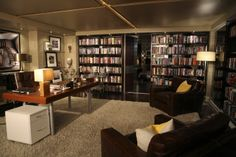 Love Castle's (tv show) office/library/studio...walls full of books on both sides and in the background, the bedroom.