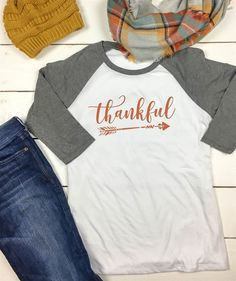 We love everything about Thanksgiving, and we know you'll love these raglans! They are made from a lightweight, comfy, tri-blend material and are PERFECT for layering on a chilly fall day!