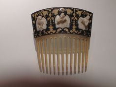 """Rene Lalique """"Breton Women"""" comb c 1900-1902 Horn, ivory and silver"""